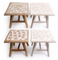 A charming assortment of natural wooden stools, sure to bring a hint of summer to any space