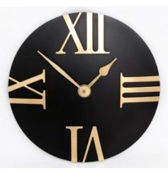 A stylish black and gold wall clock with large roman numerals.