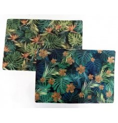 An assortment of 2 beautifully coloured luxe placemats with a palm and leaf tropical print.