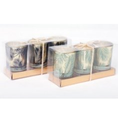 An assortment of 2 tropical design candle pots. Each set includes 3 candles.
