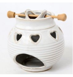 A shabby chic style oil burner with heart decorations. A lovely fragrance accessory and gift item for the home.