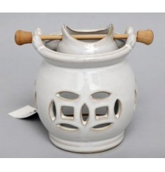 A stylish oil burner with pot. A shabby chic fragrance gift item and interior accessory.