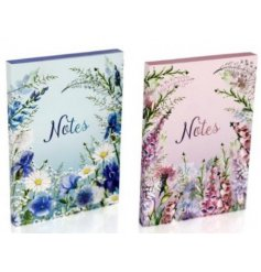 A pretty assortment of decorated notebooks featuring pink and blue tones