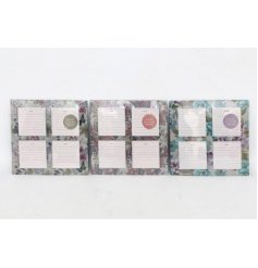 An assortment of 3 magnetic memo pads featuring floral colours and prints