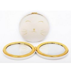 A contemporary cat design compact mirror with gold detailing.