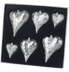 A set of 6 vintage inspired silver glass hearts with an aged finish. The set includes and assortment of sizes.