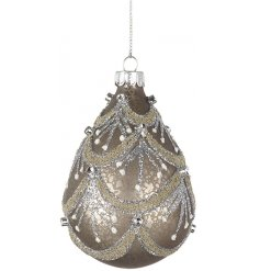 A beautifully ornate glass droplet bauble with an antique style finish, decorated in glitter.