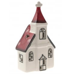 A nordic inspired red and cream ceramic house decoration with LED lights