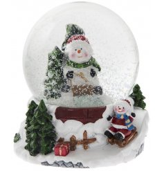 An adorable snowman water ball with a cute sleigh scene.