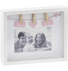 An adorable white and wooden box frame with a pink heart and Baby Girl sign.