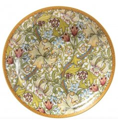 A beautifully decorated trinket dish featuring a Golden Lily print