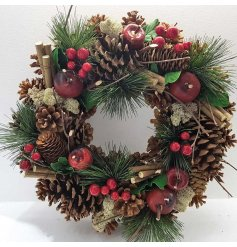 A traditional red fruits wreath with pinecones.