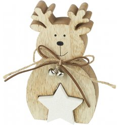 A wooden reindeer ornament with a cute cut out star and rustic bow with silver bells.