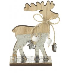 A shabby chic style wooden reindeer decoration with silver foil and a decorative bow.