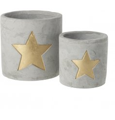 A set of 2 super stylish cement t-light holders with a gold star decoration. A top trending interior accessory