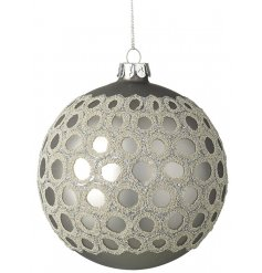 A beautifully detailed glass bauble with a champagne gold glitter decorative pattern