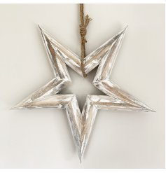 A chunky wooden star decoration with a rustic finish and rope hanger.