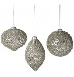 A set of 3 champagne gold glass baubles. An ornate and luxurious seasonal decoration for the home.
