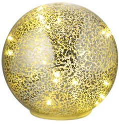 A chic dome shaped glass sphere with an antique inspired mottled finish and LED lights.