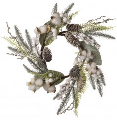 A beautiful snowy wreath with pinecones and some festive glitter.