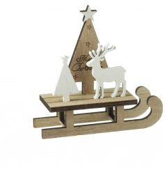 A charming wooden sleigh decoration with a Merry Christmas tree and wooden reindeer figure.