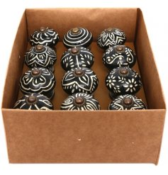 Up-cycle old furniture with these stylish black and cream decorative door knobs with antique detailing.