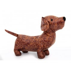 A stylish faux leather sausage dog design doorstop. A lovely gift item and interior accessory.