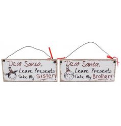 "A comical assortment of hanging metal signs featuring hand written inspired prints and ""Dear Santa"" texts"