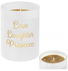 A stylish gold glitter candle in slogan pot reading Love Laughter Prosecco. A chic gift item.