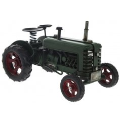 A rustic living collectable ornament. A fine quality vintage tractor in green.