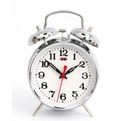 A retro style wind up alarm clock in silver. A stylish gift item and accessory for the home.