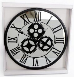 A decorative wall clock set with a mirrored base and printed mechanism decal