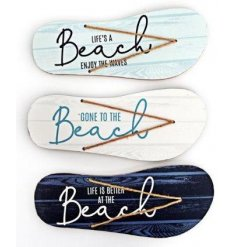 An assortment of wooden based Flip Flop Plaques each featuring Beach inspired quotes