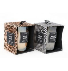 An assortment of Animal inspired printed candle pots with a White Must and Amber Vanilla scent to each
