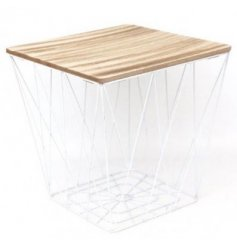 A stylish side table with a white geometric base and wooden top.