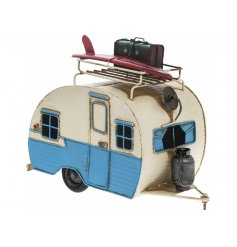 A vintage inspired caravan model featuring surf board and suitcase. A seaside gift with plenty of coastal charm.