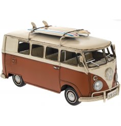 A vintage VW camper van model in orange. A chic seaside ornament with plenty of coastal charm.