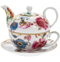 A vintage inspired floral tea for one set, including a teapot and teacup.