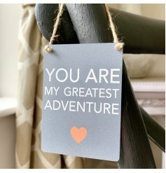 A Sweet and simple hanging metal sign featuring a sentimental quote