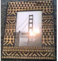 A beautifully detailed wooden photo frame with an African inspired print.