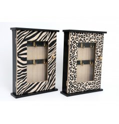 An assortment of 2 wooden key storage units in zebra and leopard print designs.