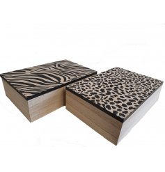 An assortment of 2 wooden tea boxes with slogan. Each mix includes a zebra and leopard print pattern and tea slogan.