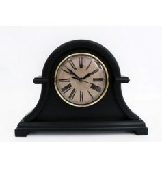 A vintage inspired decorative Mantle Clock featuring a distressed clock face and black tone