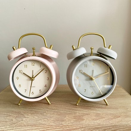 An assortment of 2 chic pink and grey pastel coloured clocks with gold detailing.