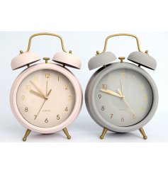 A mix of 2 pastel coloured alarm clocks with chic gold detailing.