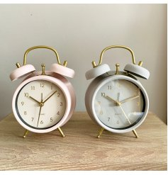 An assortment of 2 alarm clocks in chic grey and pink pastel colours. Complete with gold detailing.