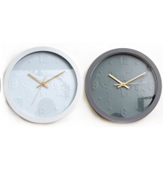 An assortment of 2 contemporary clocks with an embossed map design. A stylish interior accessory.