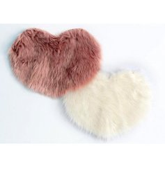 these pink and cream toned heart shaped rugs will be sure to bring a trending touch to any home space