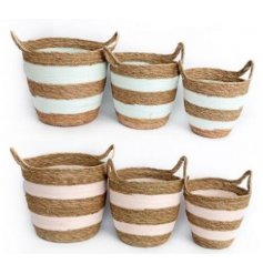 An assorted set of coloured and sized woven baskets, perfect storage accents for any home