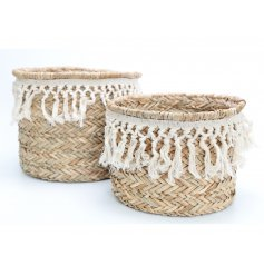A set of 2 on trend storage baskets with a woven pattern and macrame trim.